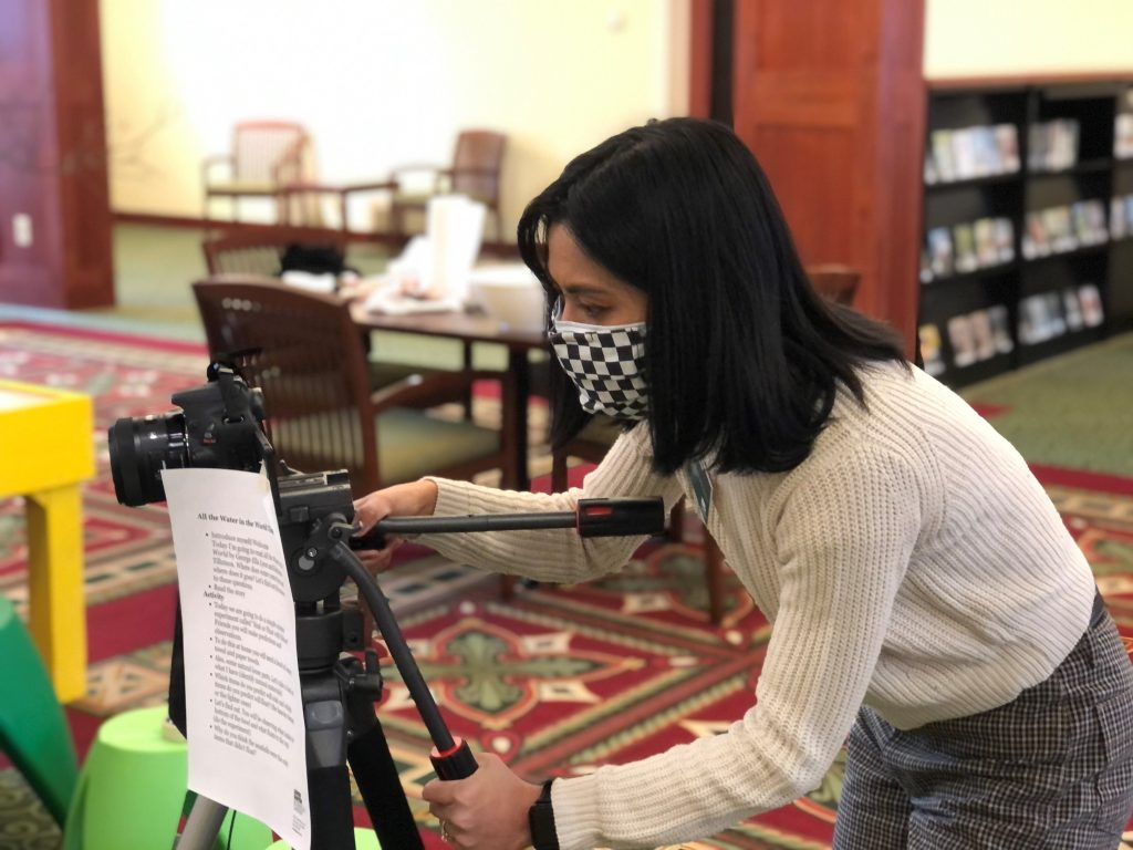 Claudine Reyes sets up camera to film virtual storytime.