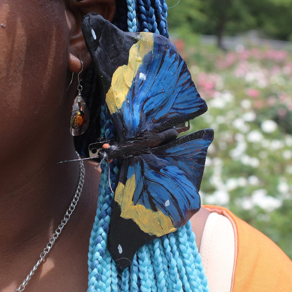 Unicia Buster and her blue butterfly earring