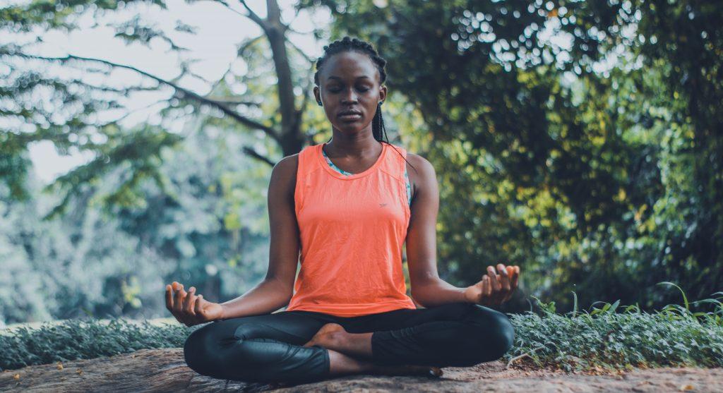 Woman meditating PYR Yoga. Image by Oluremi Adebayo, Pexels