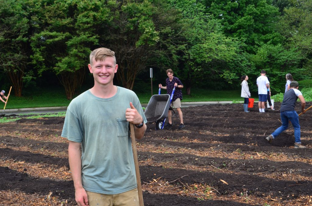 Sustainable Agriculture Gardener Conor Collins in the Community Kitchen Garden
