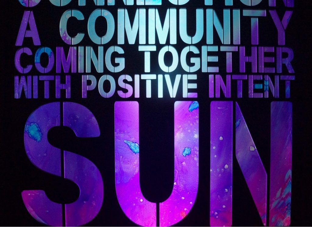 Poems of Positivity art from Orlosky Studio. Text says: A Community Coming Together with Positive Intent.